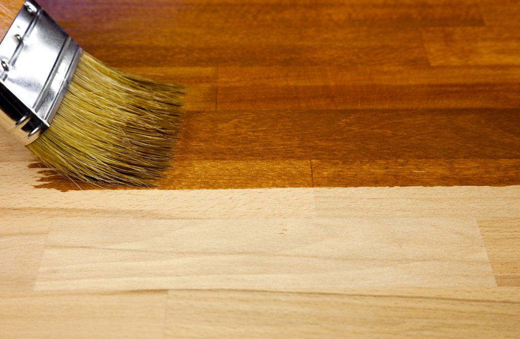 Brush painting varnish on hardwood