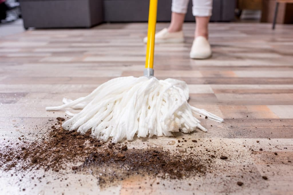 Close up of a mop cleaning debris