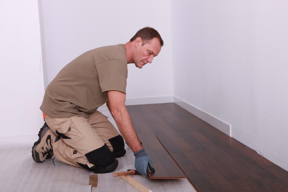 A man installing floating floor