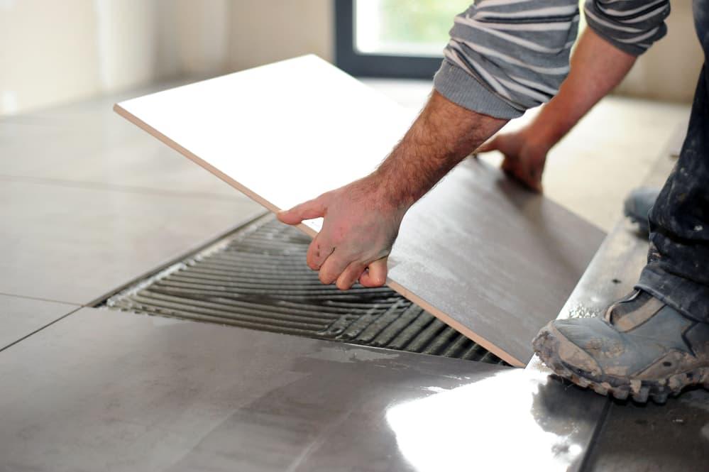 Man laying floor tiles
