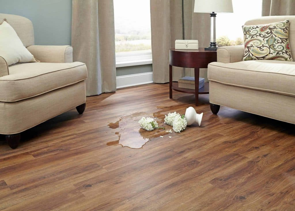 beige nucore flooring with water from a vase spilled
