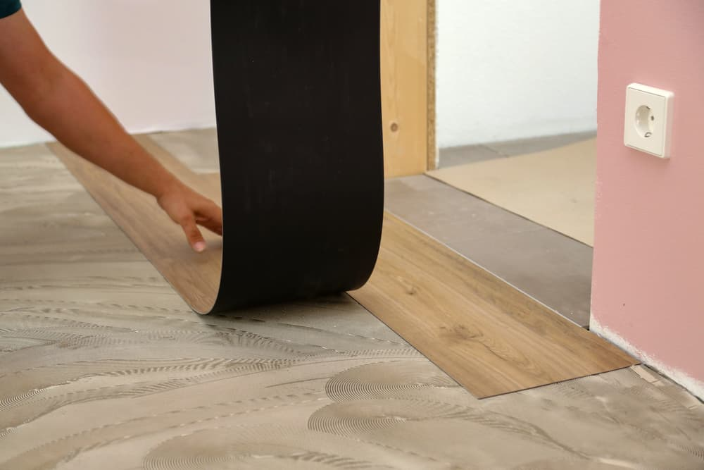 vinyl flooring being installed